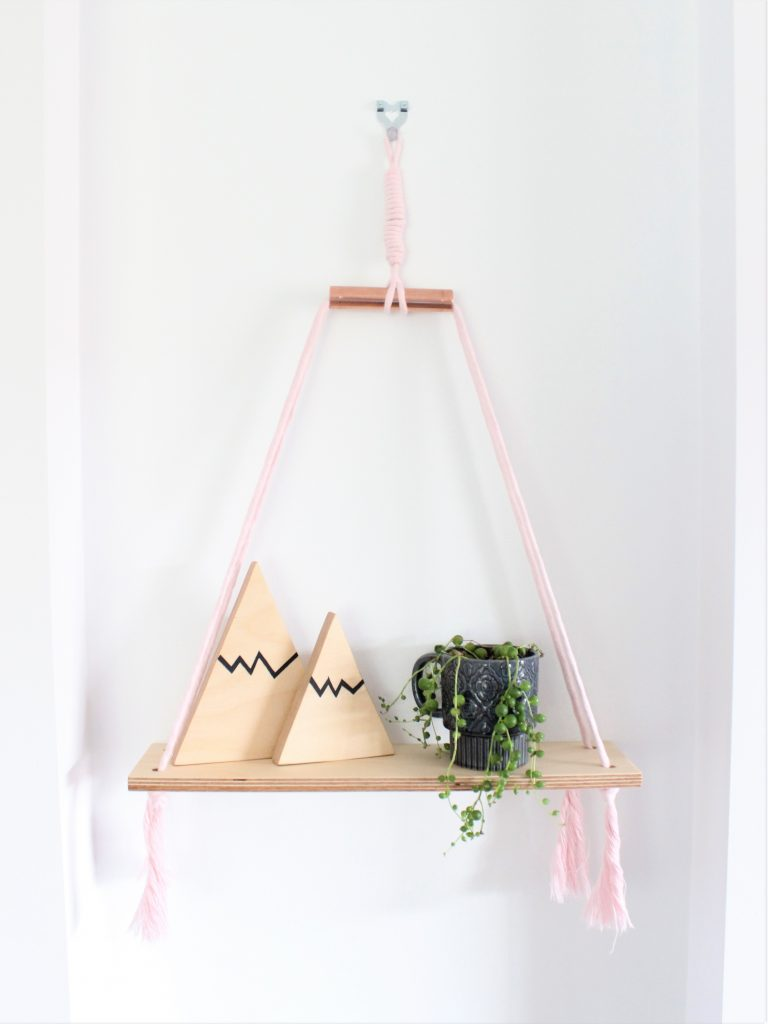 Baby pink macrame cord with birch plywood shelf and copper accent with two hand painted mountain shelfies and a string of peals in a vintage mug