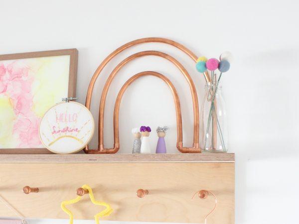 Copper Rainbow sitting on a peg shelf in a girls bedroom
