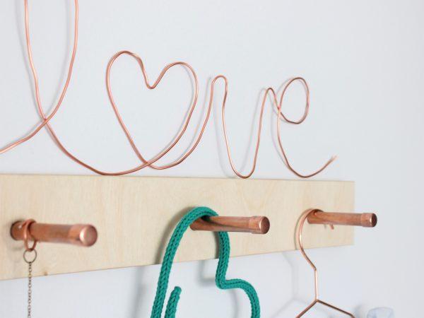 Copper peg rail with copper love sign