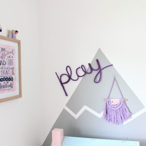 play knitted neon sign in purple