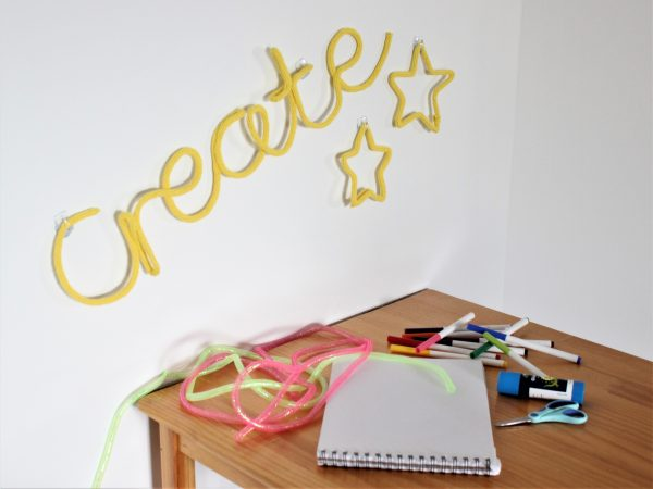 create knitted neon sign in yellow