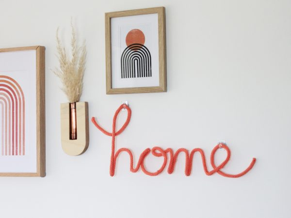 home knitted neon sign in coral